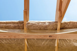New residential construction home framing beams with insulation layer